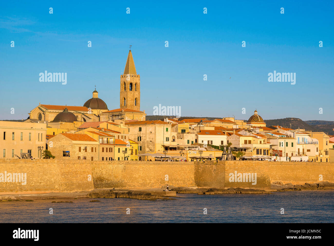 Alghero cityscape, view of the skyline and the huge sea wall - or bastioni- along the western side of Alghero, summer, - Stock Image