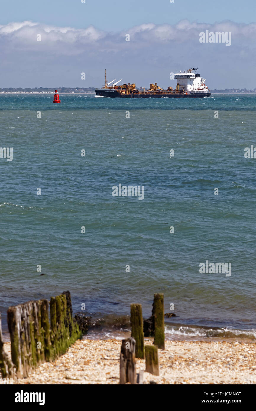 The Sand Heron a 'suction hopper dredger' owned by Cemex Aggregates Marine Ltd makes her way across Southampton Stock Photo