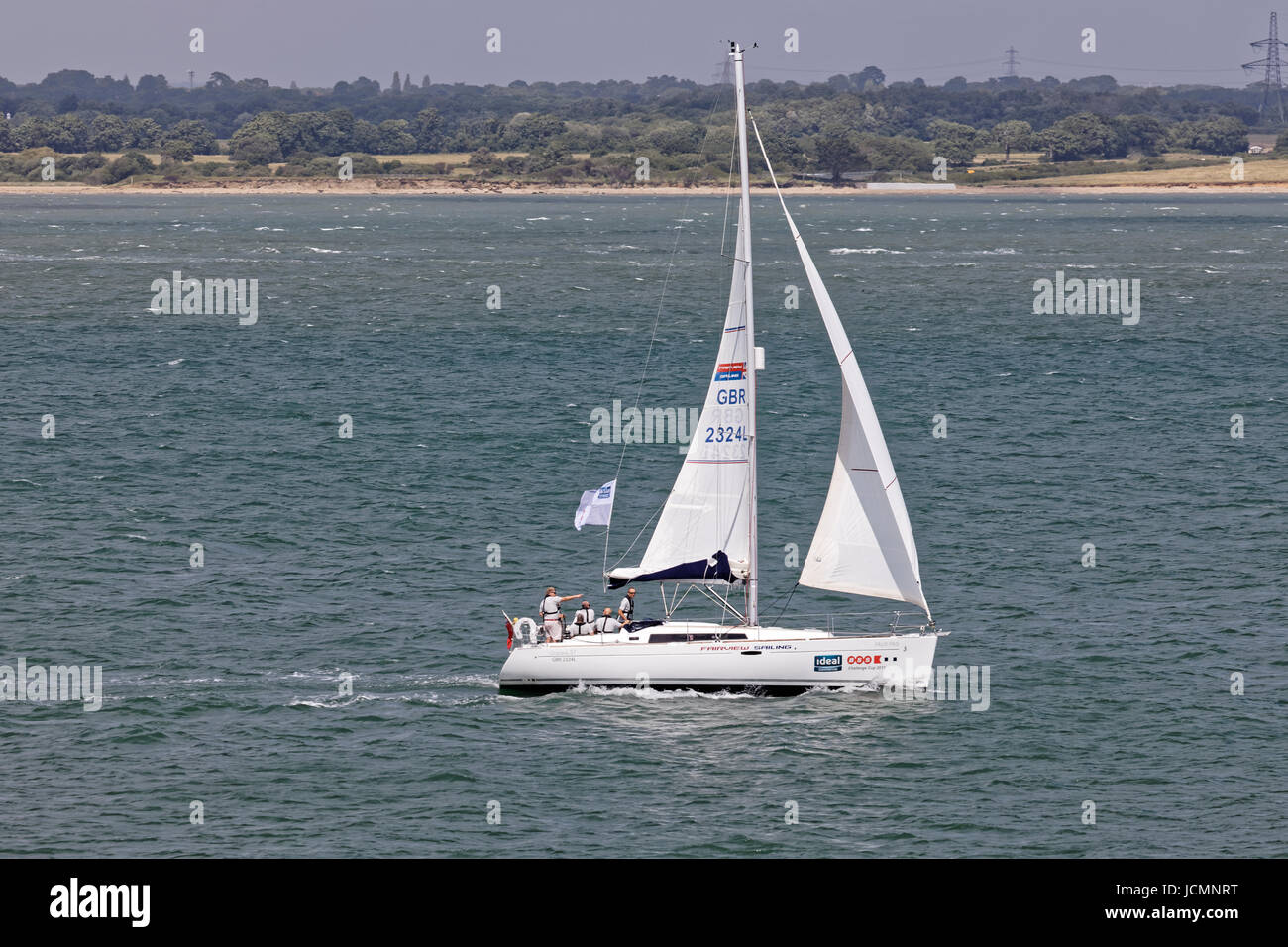 Farview Sailing Yacht Charter Company's Oceanis 37 Faux Pas Yacht and crew in the Solent - Stock Image