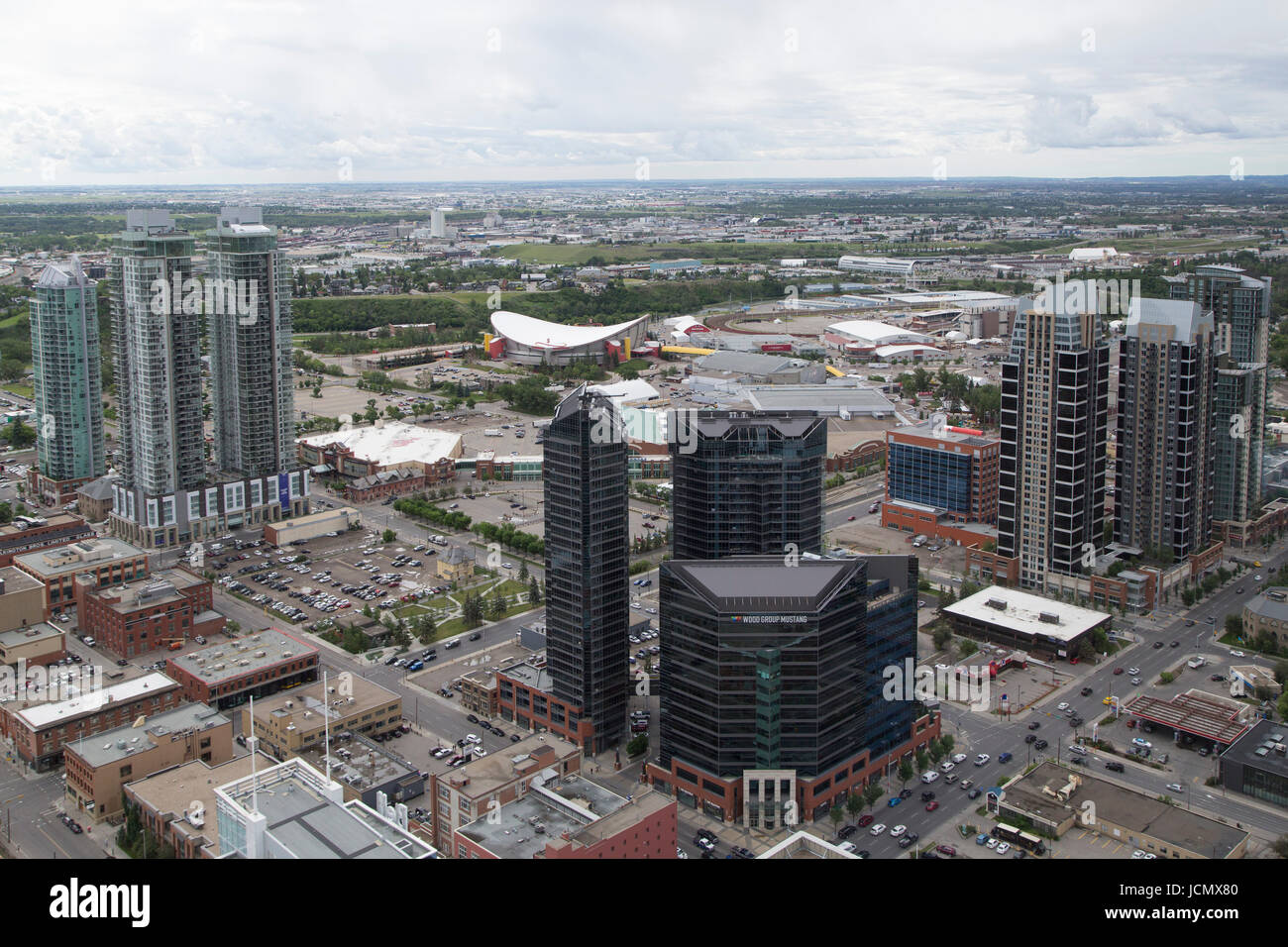 Buildings in downtown Calgary, Canada. The Saddledome, the home of the Calgary Flames, and Stampede Park, lies beyond - Stock Image