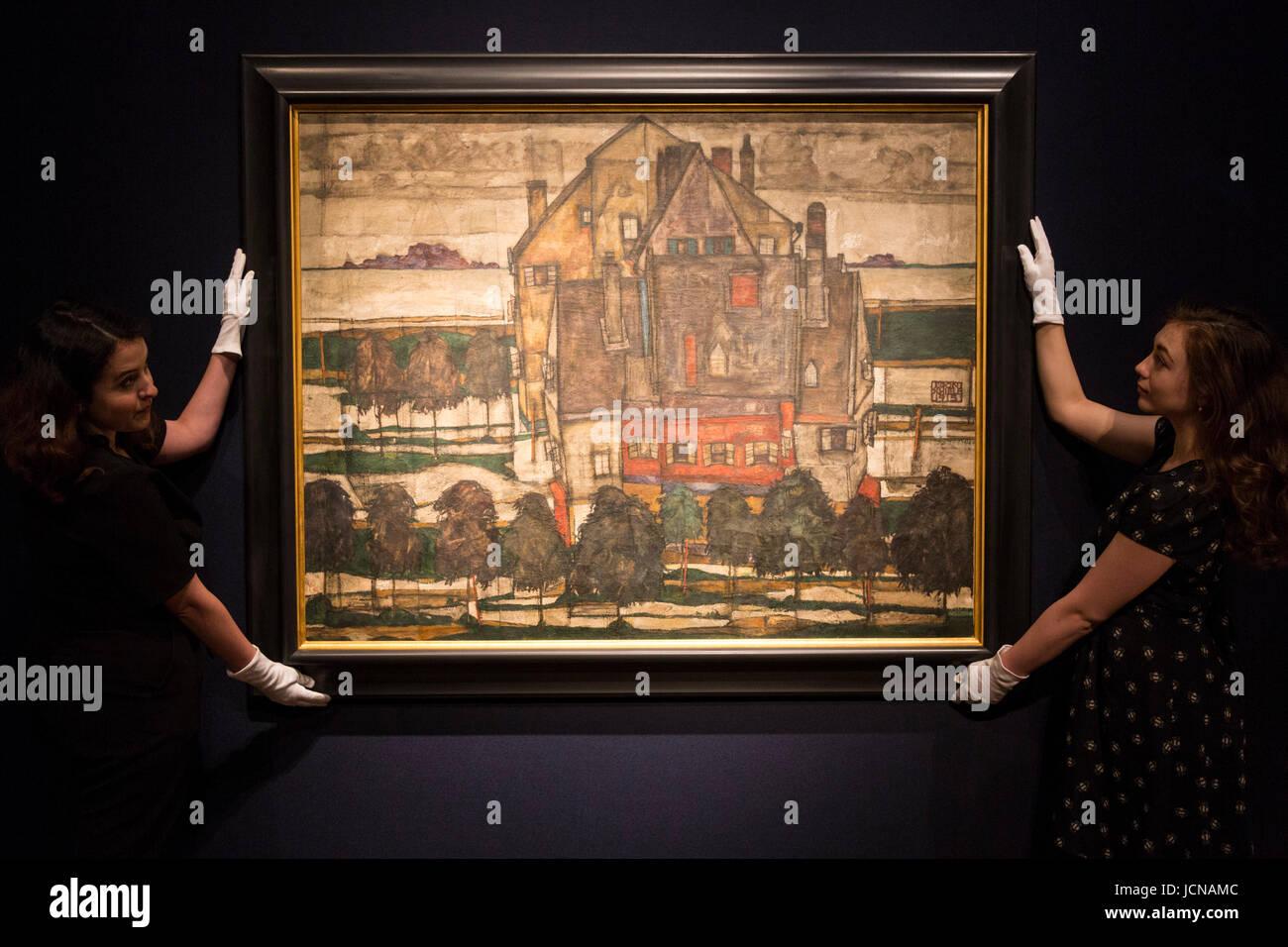 London, UK. 16 June 2017. Christie's employees handling the painting Einzelne Haeuser (Haeuser mit Bergen), - Stock Image