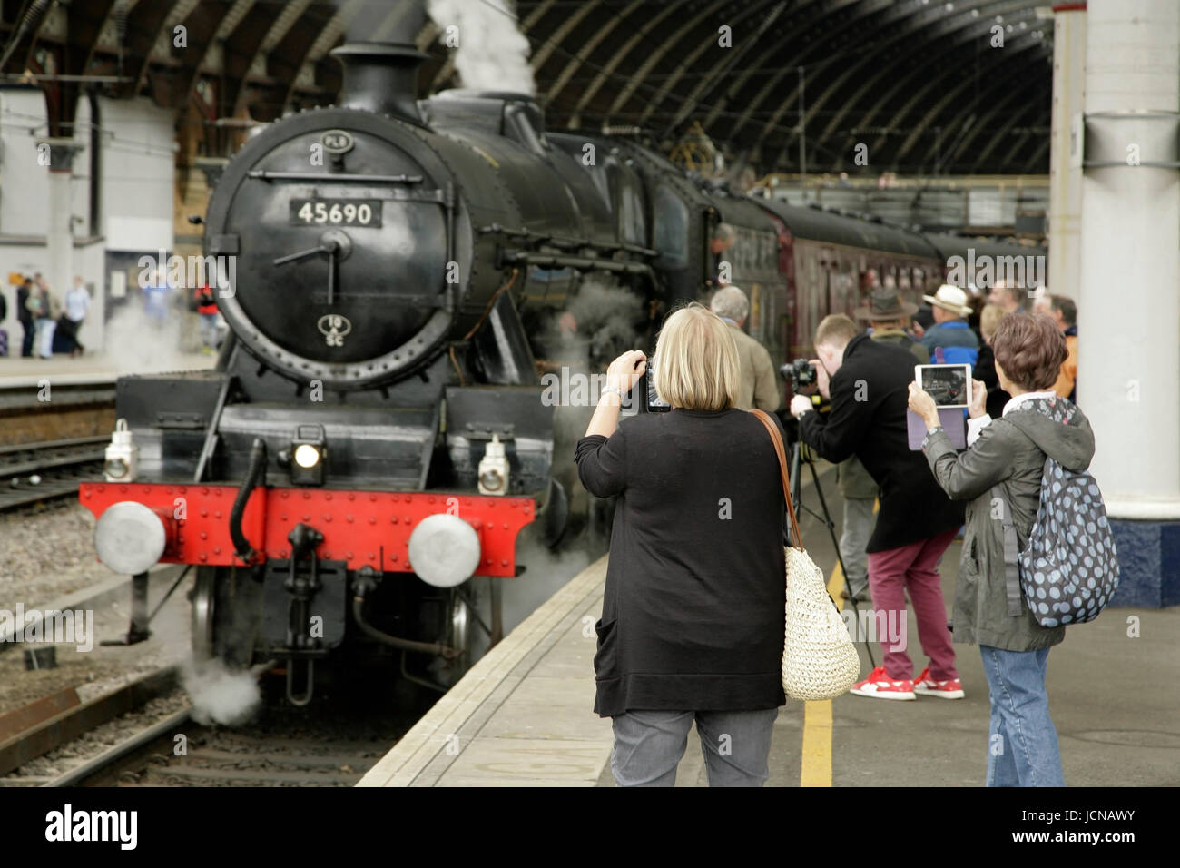 LMS Jubilee class steam locomotive 45690 'Leander' at York station, UK with the Scarborough Spa Express - Stock Image