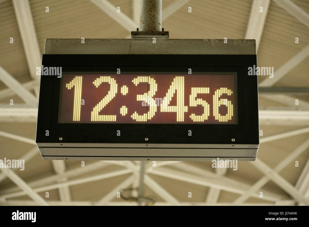 Digital clock reading 34 minutes and 56 seconds past 12 - Stock Image