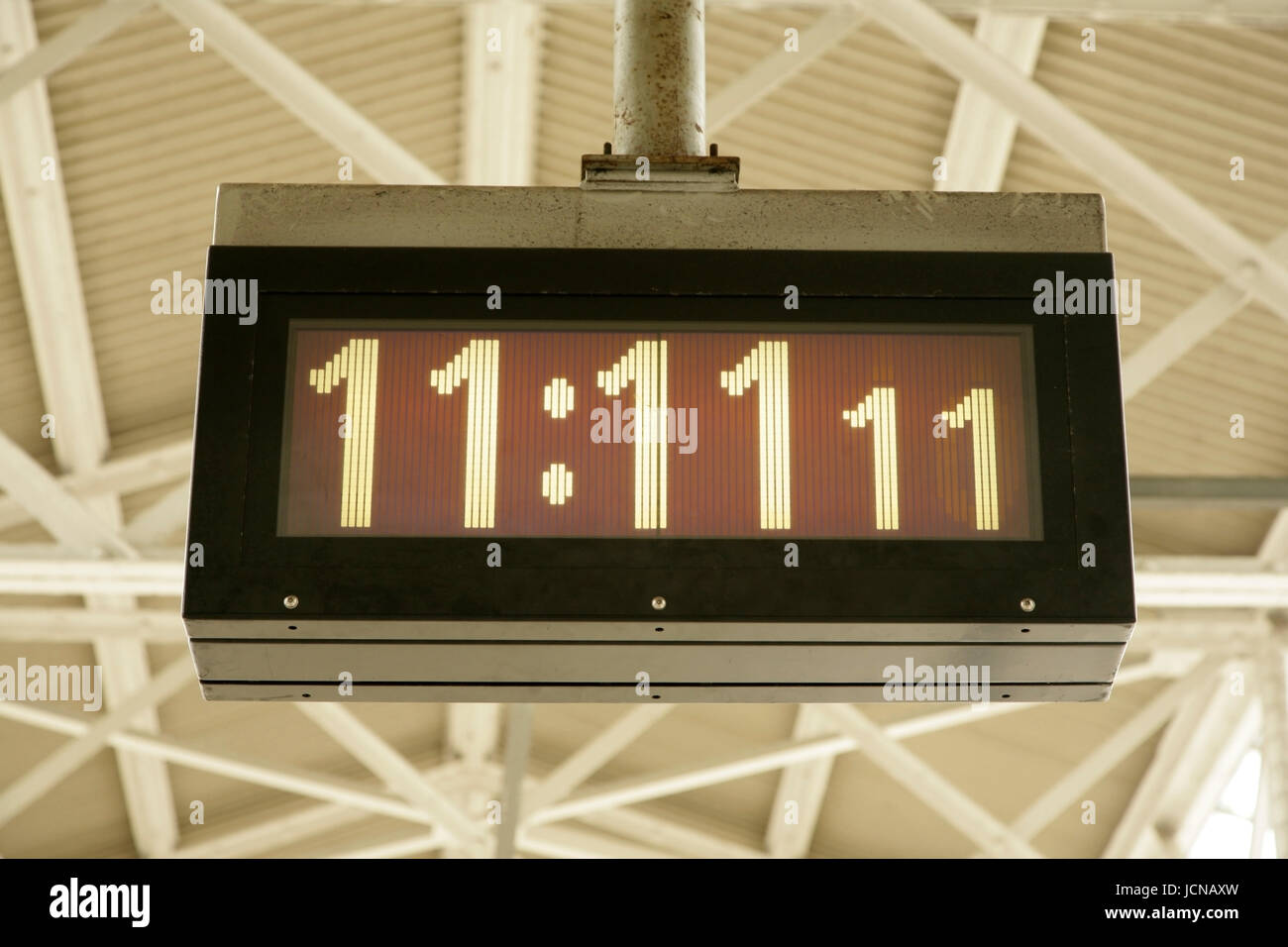Digital clock reading eleven minutes and eleven seconds past eleven - Stock Image