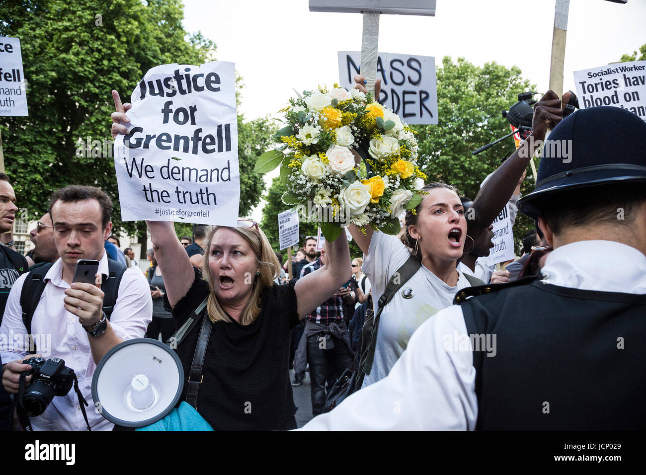 London, UK. 16th June, 2017. Justice for Grenfell Protest outside Downing Street. Protesters call for a full investivation - Stock Image