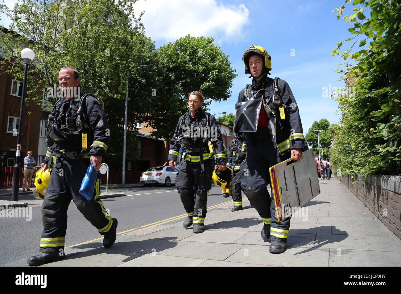 London, UK. 16th June, 2017. Firefighters around the Grenfell Tower block of flats in West London after the building - Stock Image