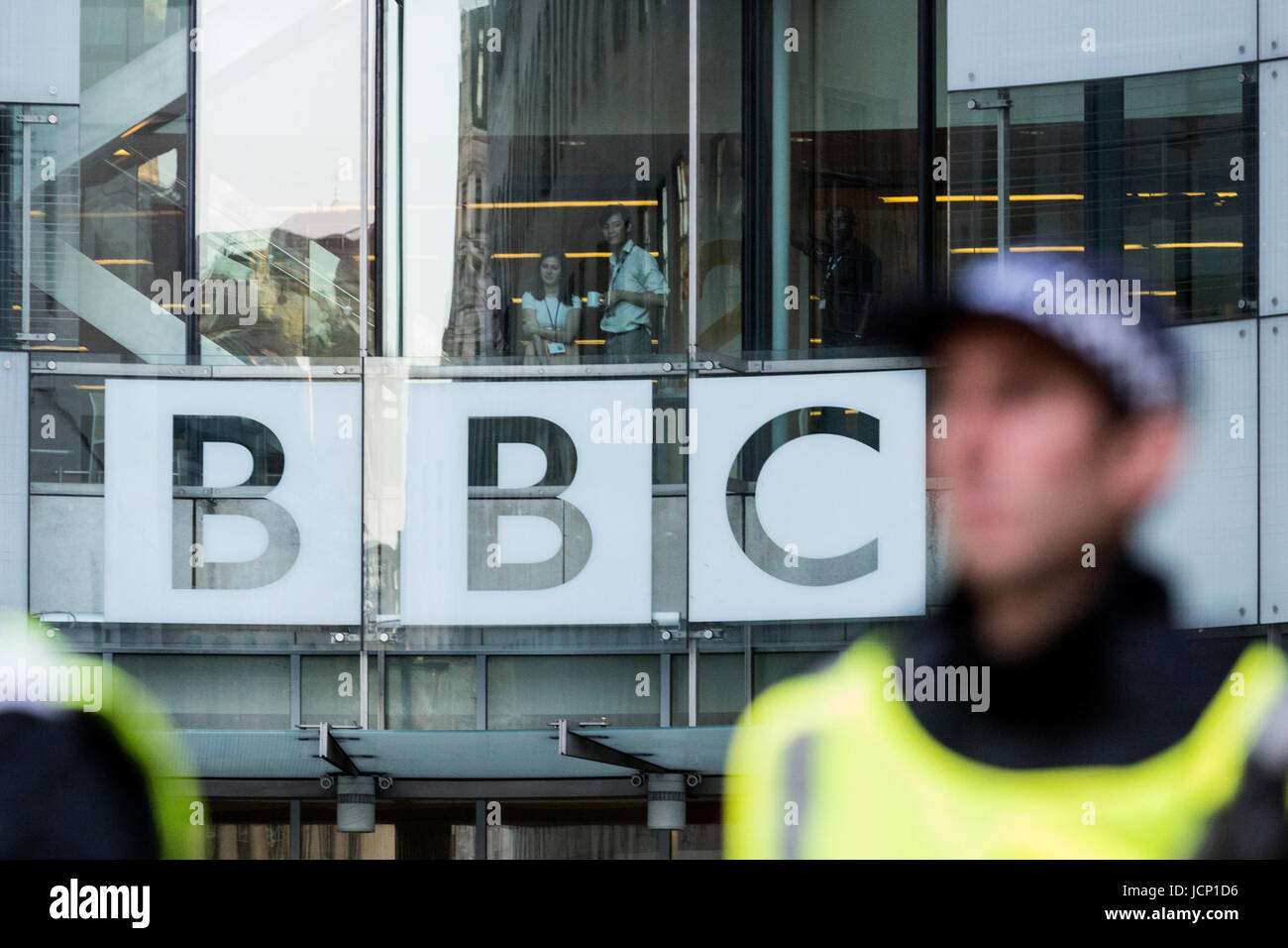 London, UK, 16 June 2017. BBC employees watch the protesters at the Justice for Grenfell Protest outside Broadcasting - Stock Image