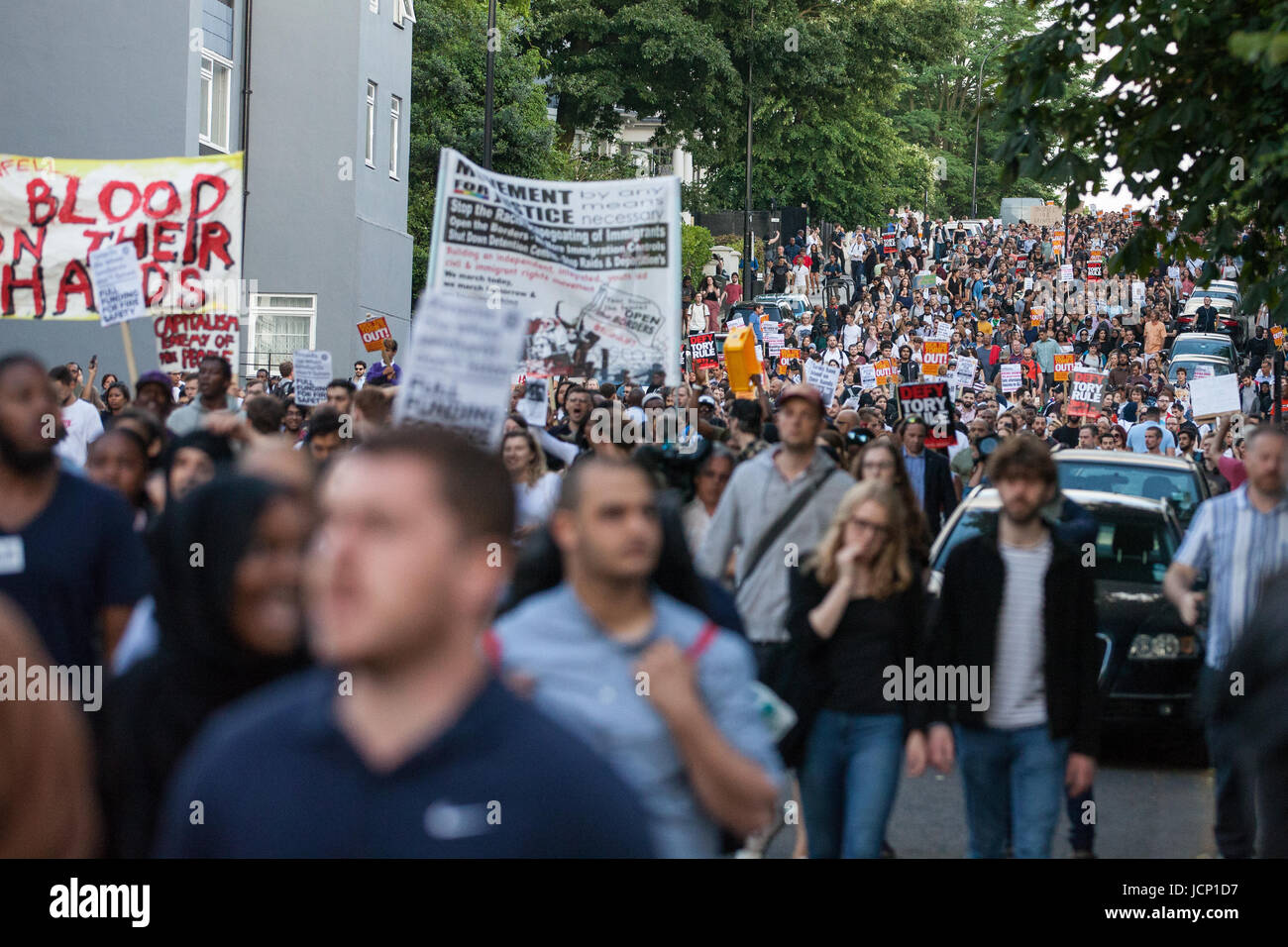 London, UK. 16th June, 2017. Members of the community of North Kensington take part in a protest march to demand Stock Photo