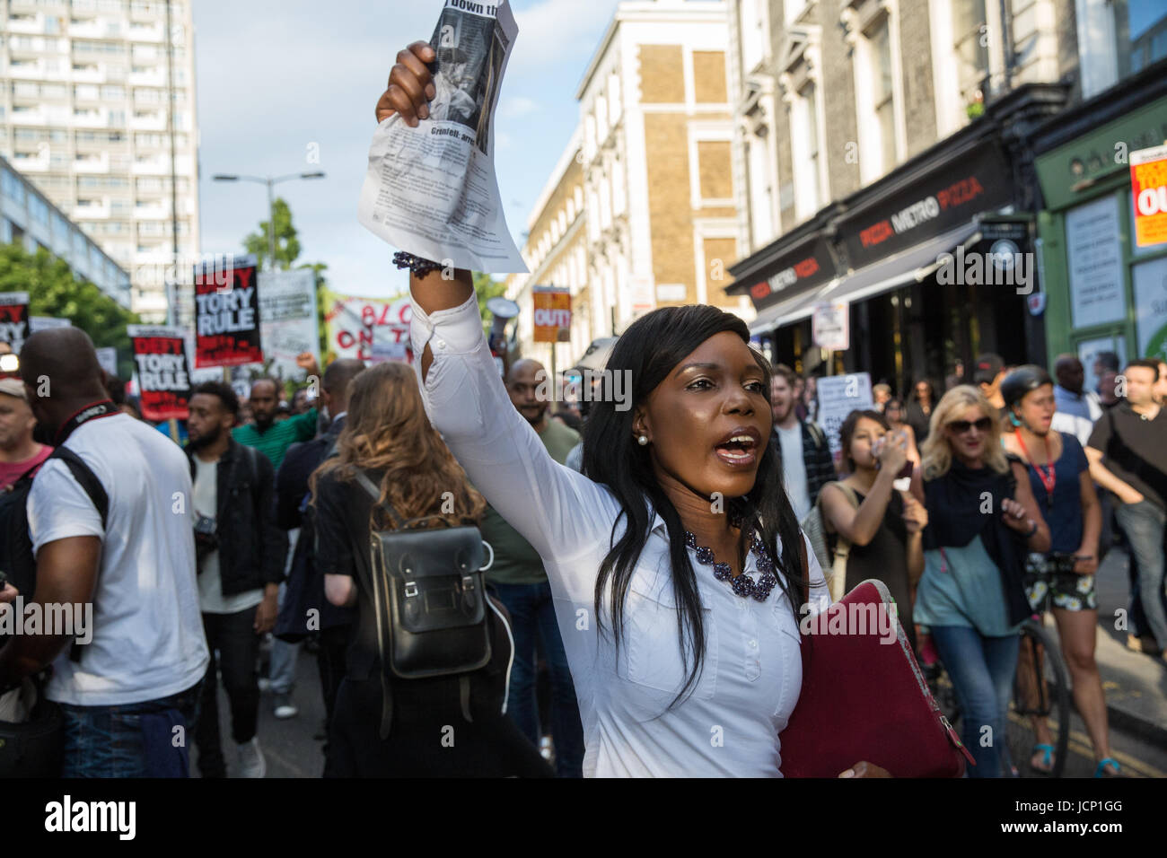 London, UK. 16th June, 2017. Members of the community of North Kensington take part in a protest march to demand - Stock Image