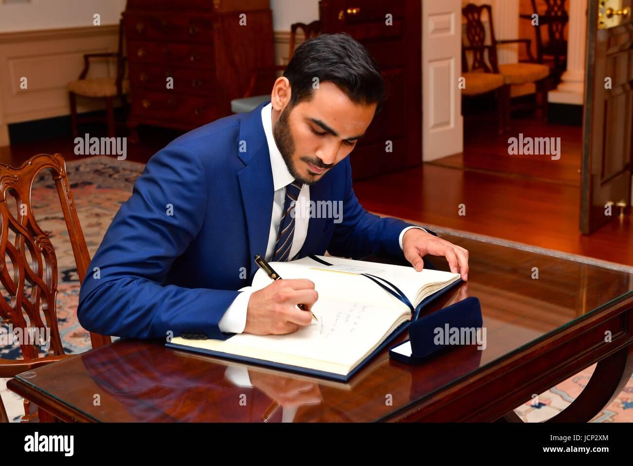 Qatari Secretary to the Emir for Investments Sheikh Mohammed bin Hamad bin Khalifa Al Thani signs the guest book Stock Photo