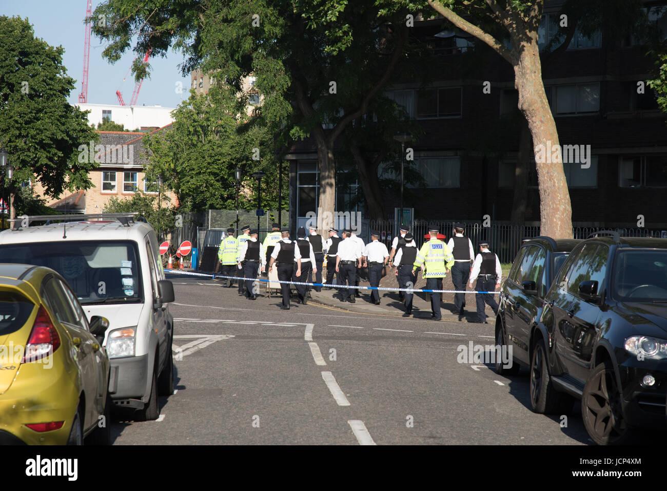 Kensington, London, UK. 17th June, 2017. Policemen reporting for duty saturday morning. Scenes around Latimer road - Stock Image