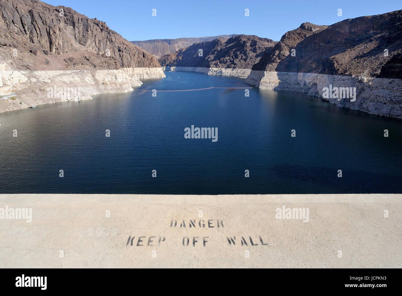 Warning notice  on parapet at Lake Mead from the Hoover Dam Arizona/Nevada border USA - Stock Image