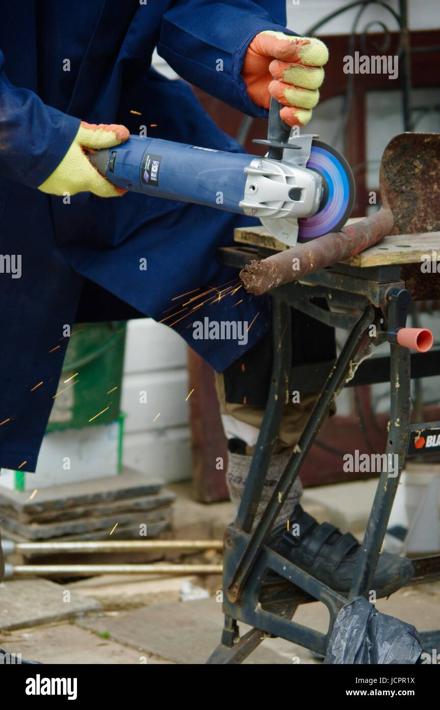 DIY with an Angle Grinder. Exeter, Devon, UK. July, 2015. - Stock Image