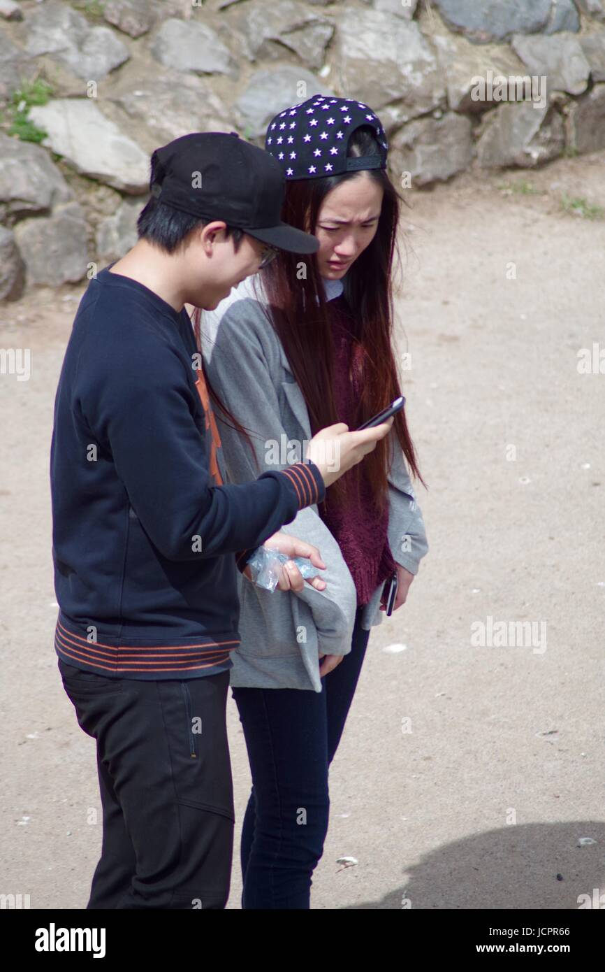 Asian Tourists at Exeter Quay. Devon, UK. June, 2017. - Stock Image