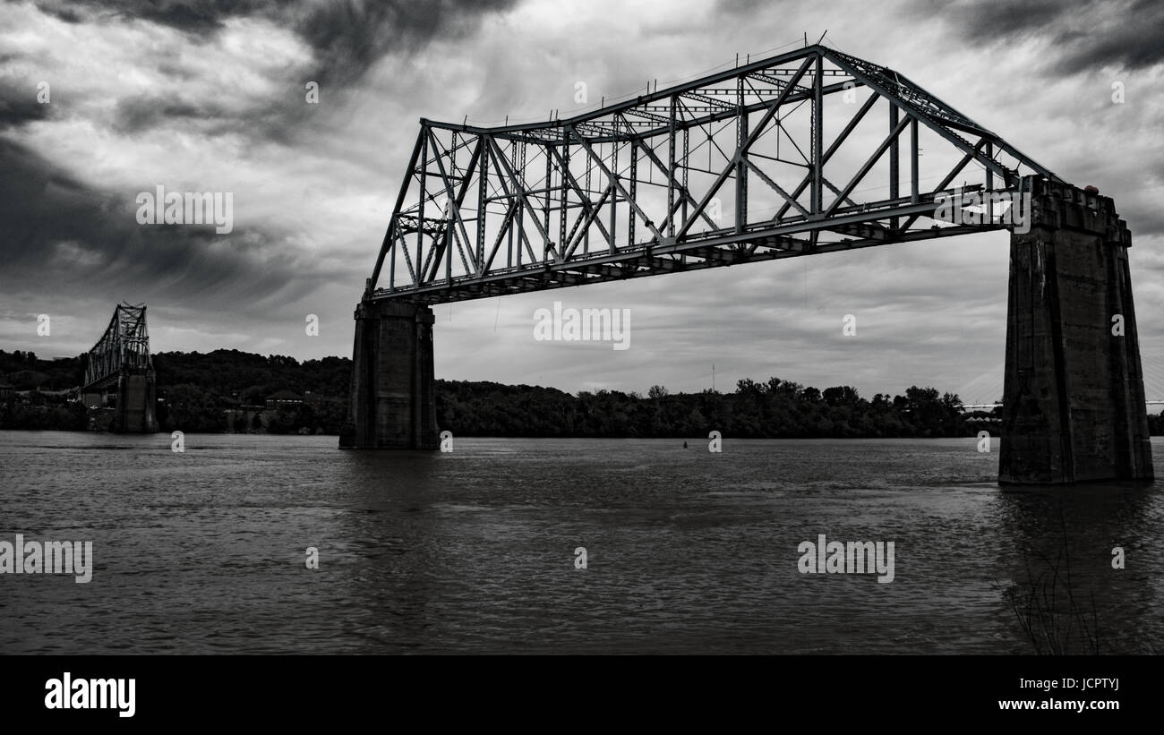 The old bridge stands stoic over the river the morning of its destruction. - Stock Image