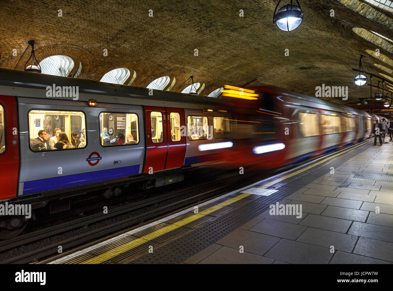 Underground (Tube) train car and another one streaking by, Baker Street Underground Station, London, England, United Stock Photo