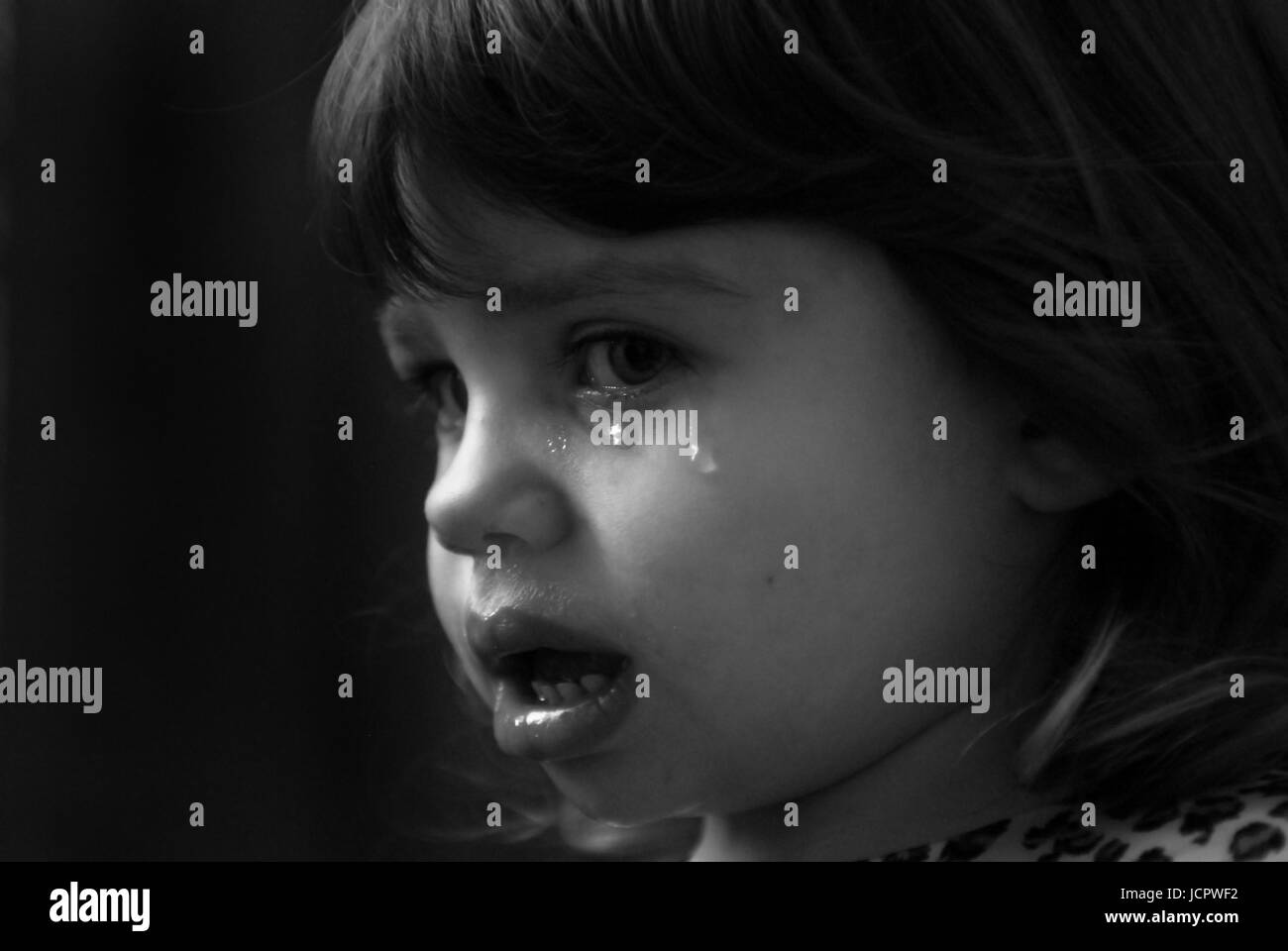 crying girl toddler with tears - Stock Image