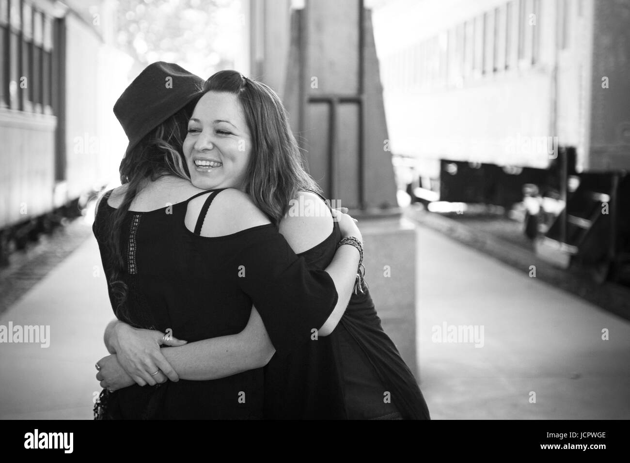 Black clear all filters page 1 of 3 reunited friends hugging at train station stock image