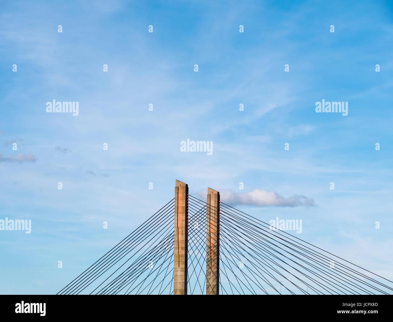 Detail of pillars and cables of Martinus Nijhoff Bridge and river Waal near Zaltbommel, Gelderland, Netherlands - Stock Image