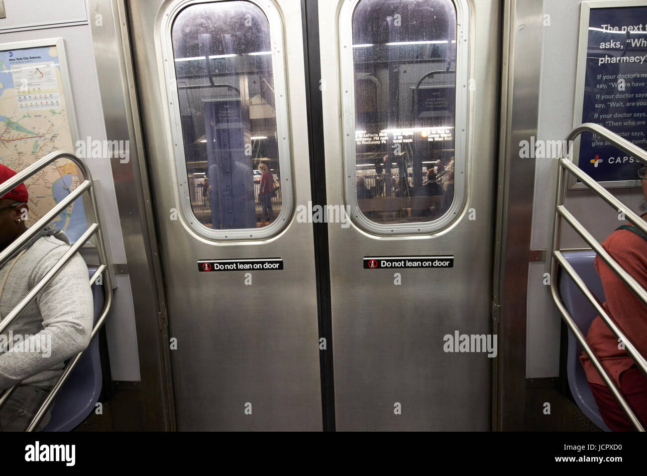 closed doors on board carriage of new york subway c line train New York City USA - Stock Image