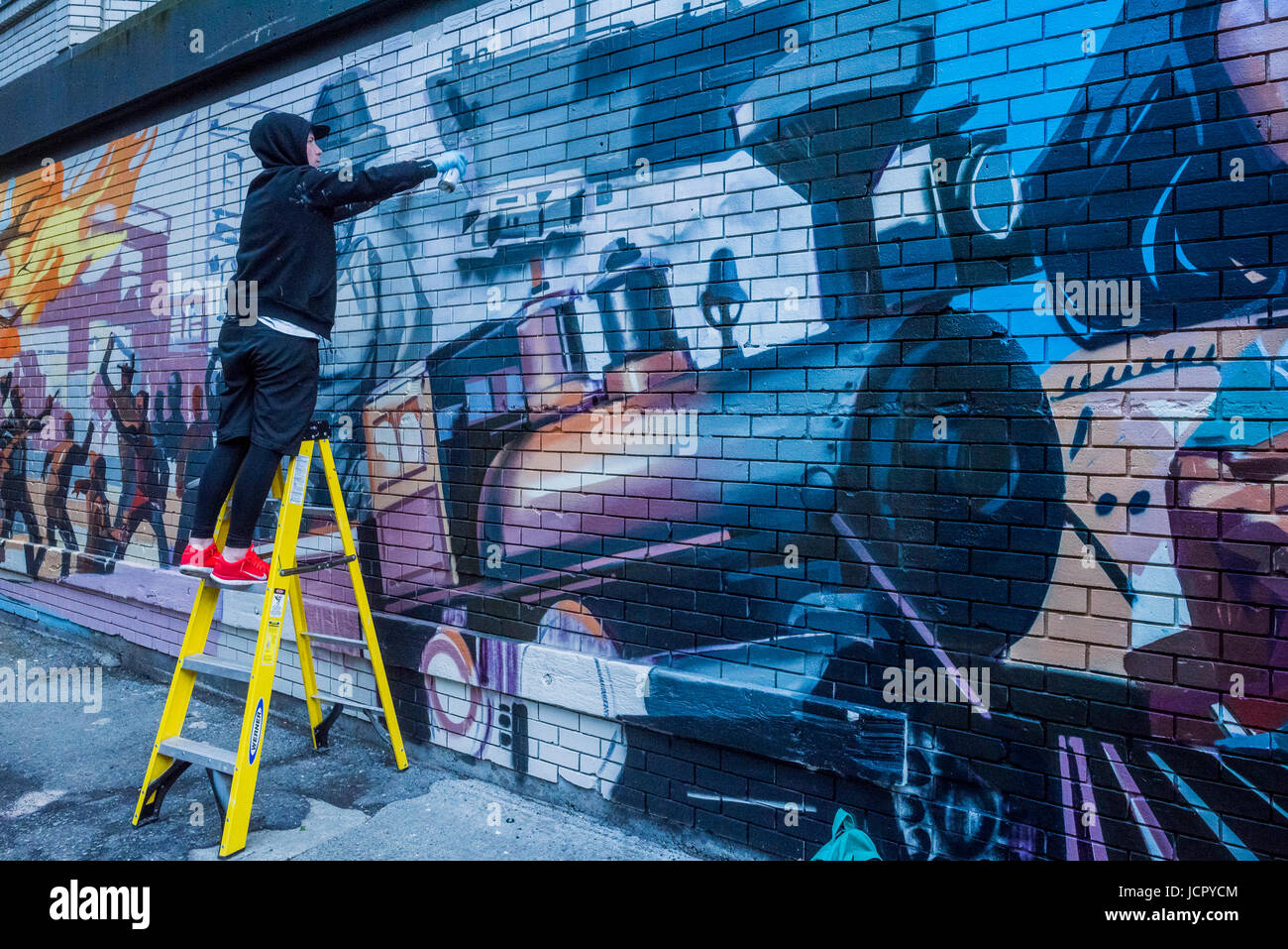 Mural painting in progress, depicting 100 years of Vancouver history, DTES, Gastown, Vancouver, British Columbia, Stock Photo