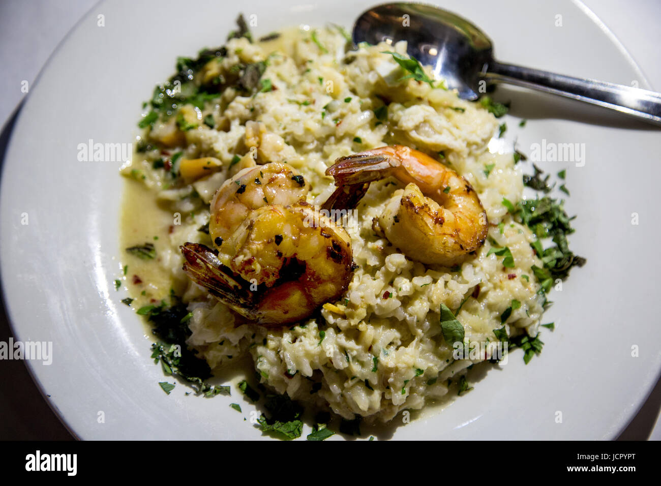 shrimp over rice with herbs - Stock Image