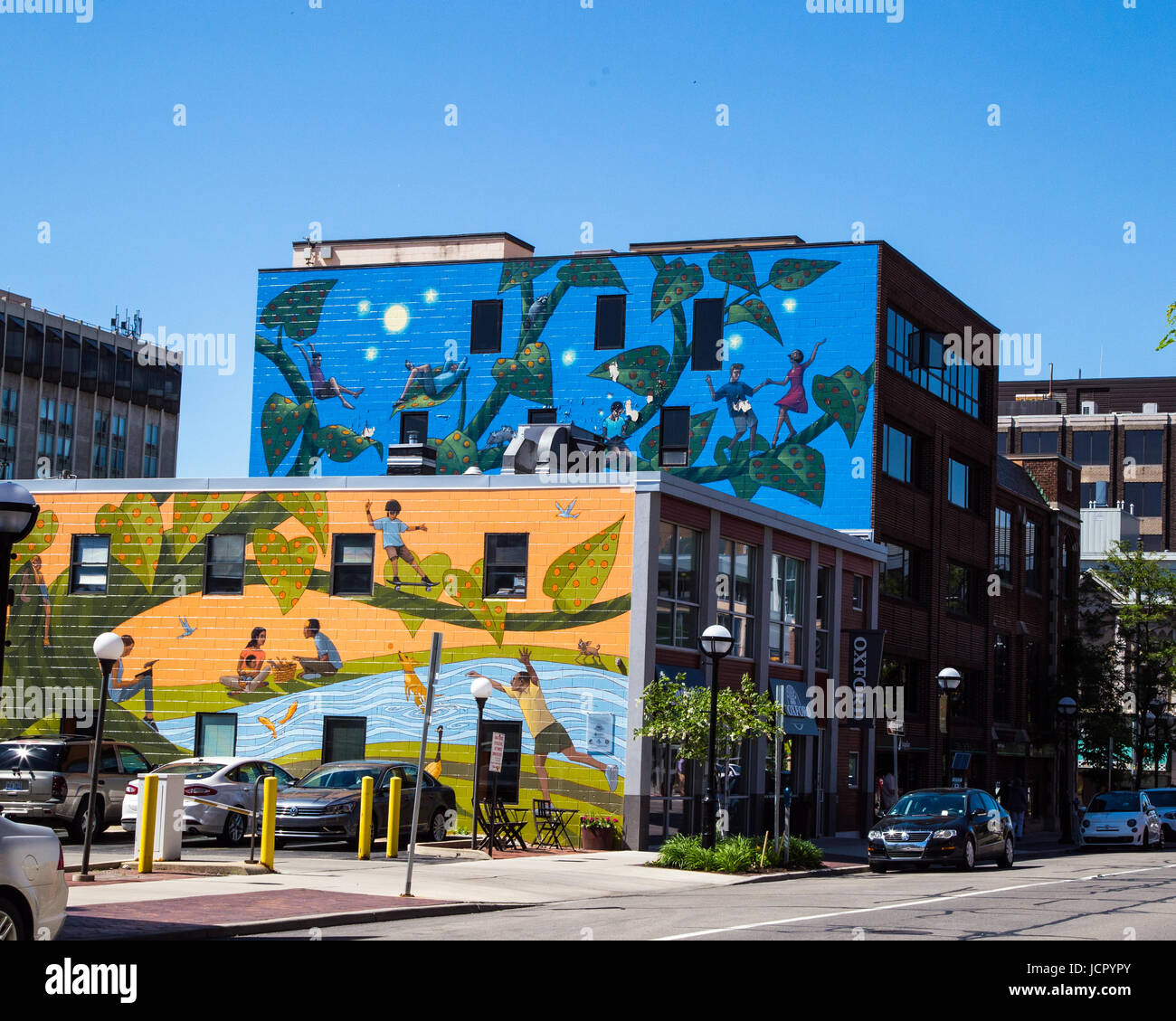 Wall murals grace the building wall in Ann Arbor Michigan - Stock Image