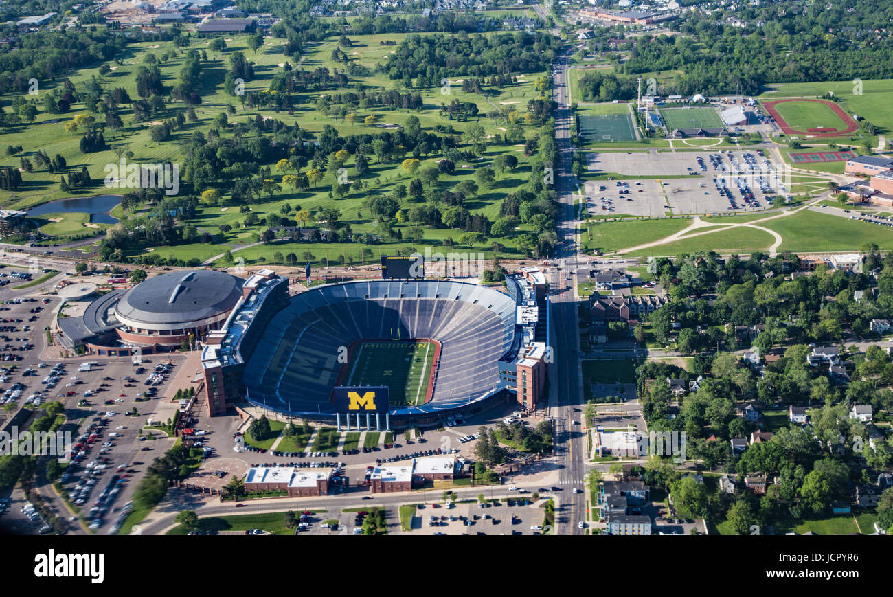 View of University of Michigan's Big House football stadium from the air, including views of the city - Stock Image
