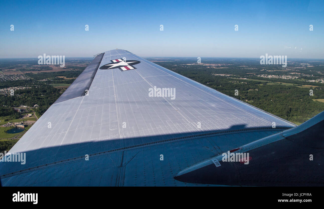 view of the wing of a c-47 over Ann Arbor Michigan - Stock Image
