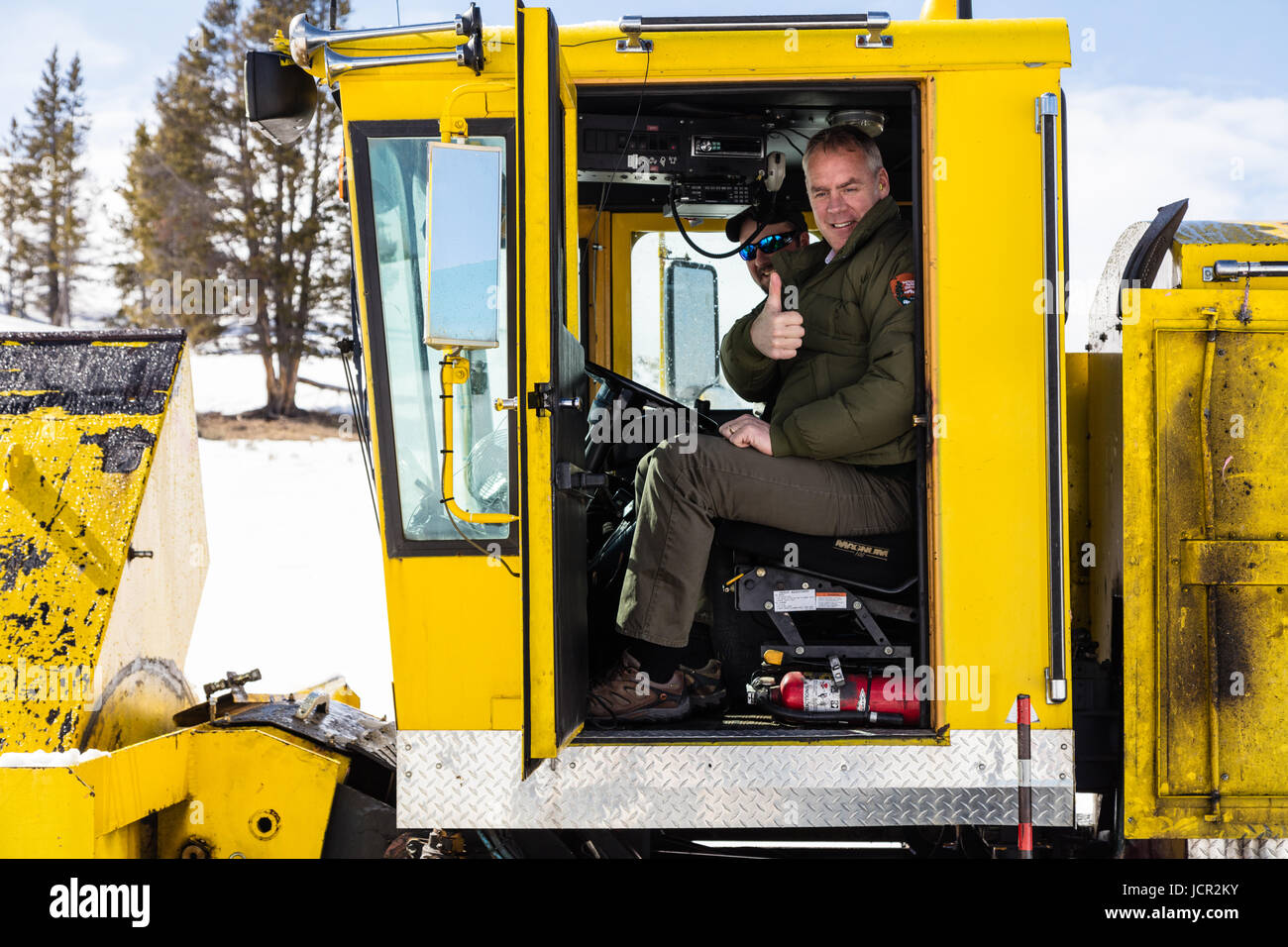 U.S. Interior Secretary Ryan Zinke rides a snowblower during a visit to the Yellowstone National Park March 17, - Stock Image