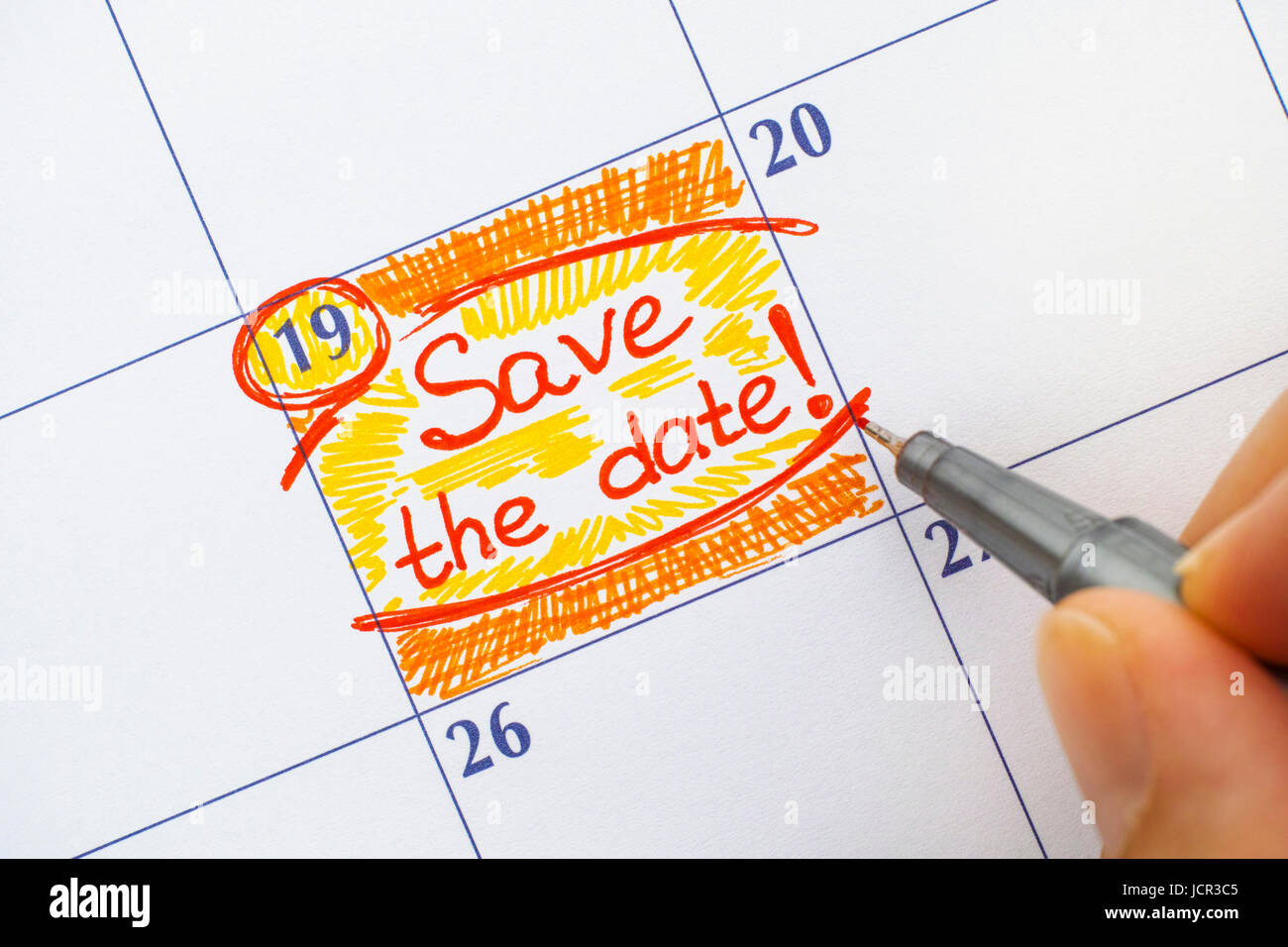 woman fingers with red pen writing reminder save the date stock