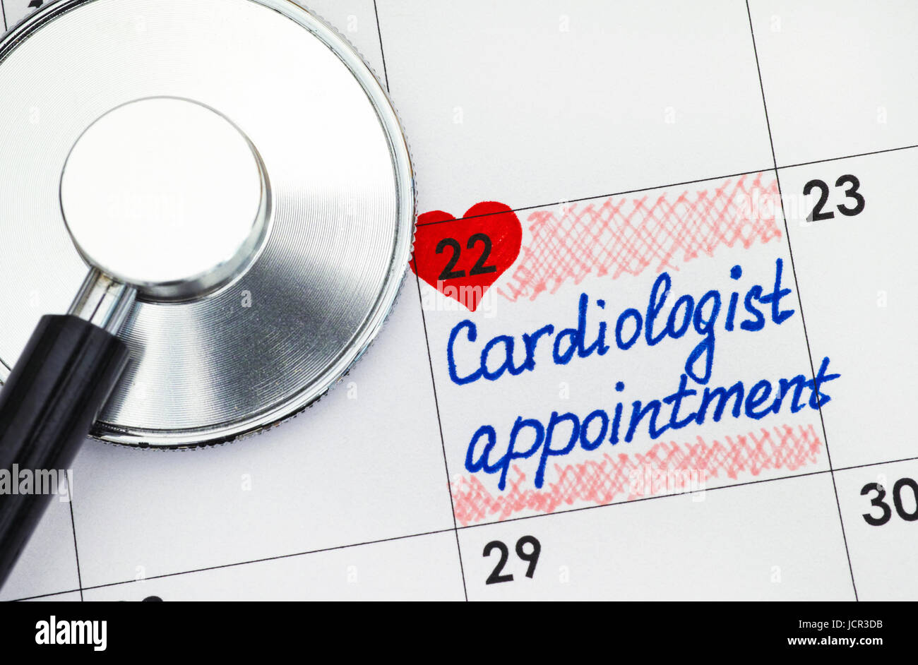 Reminder Cardiologist Appointment in calendar with stethoscope. - Stock Image