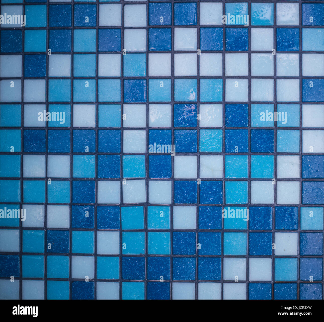 Background of small floor tiles in the bathroom, all shades of blue ...