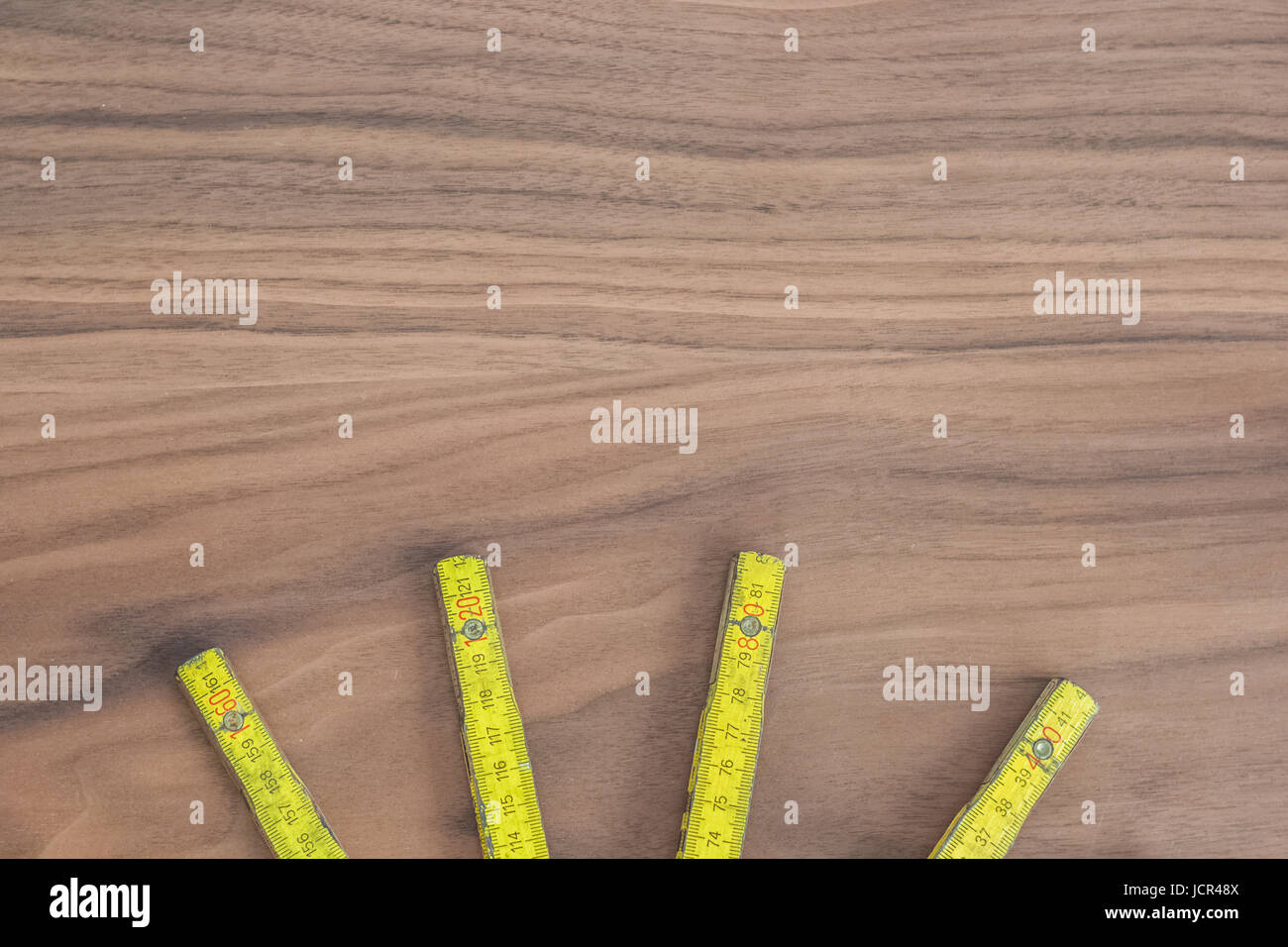 Measuring tool, wooden meter stick on a table - Stock Image