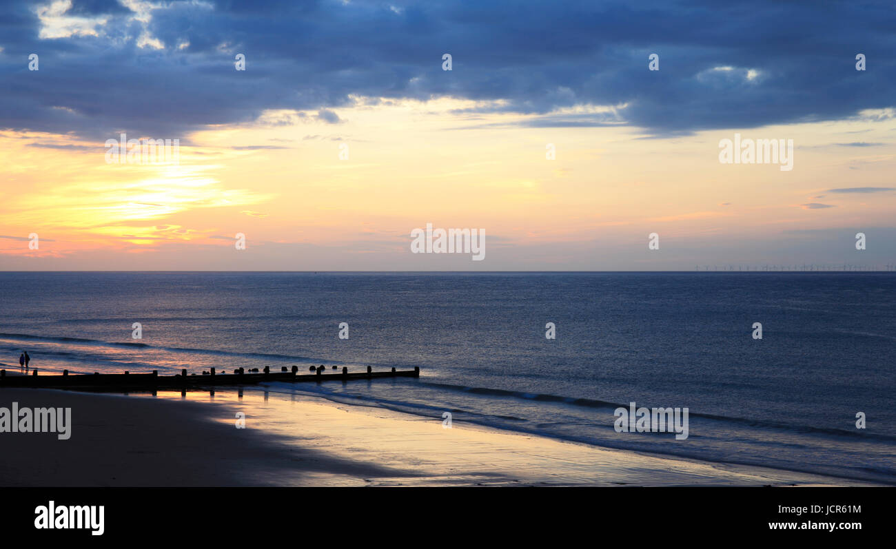 The sun sets over The North Sea and Cromer Beach, Cromer, Norfolk, England, Europe - Stock Image