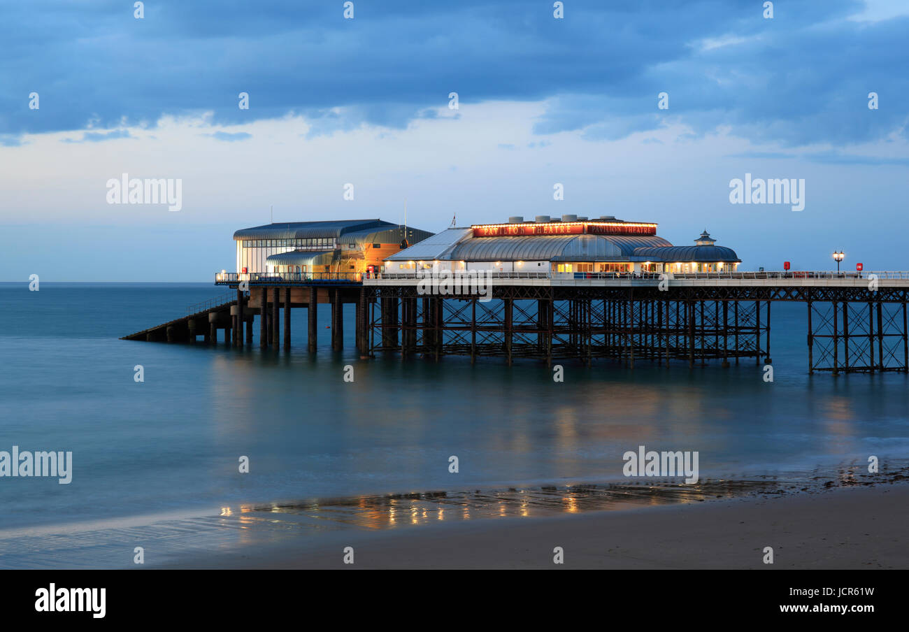 Dusk descends on Cromer's pier, North Norfolk, England, Europe - Stock Image