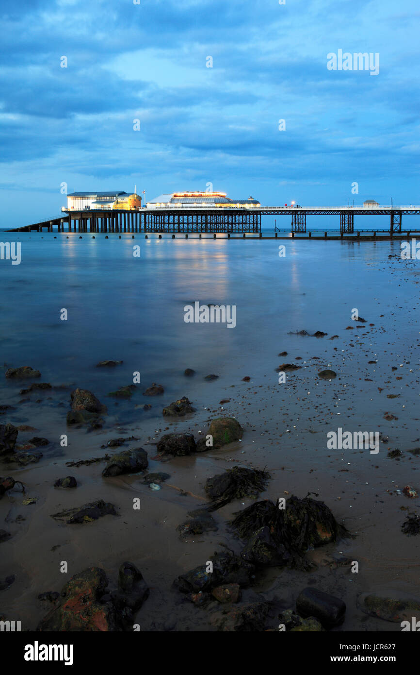 The traditional pier at night , Cromer, North Norfolk, England, Europe - Stock Image