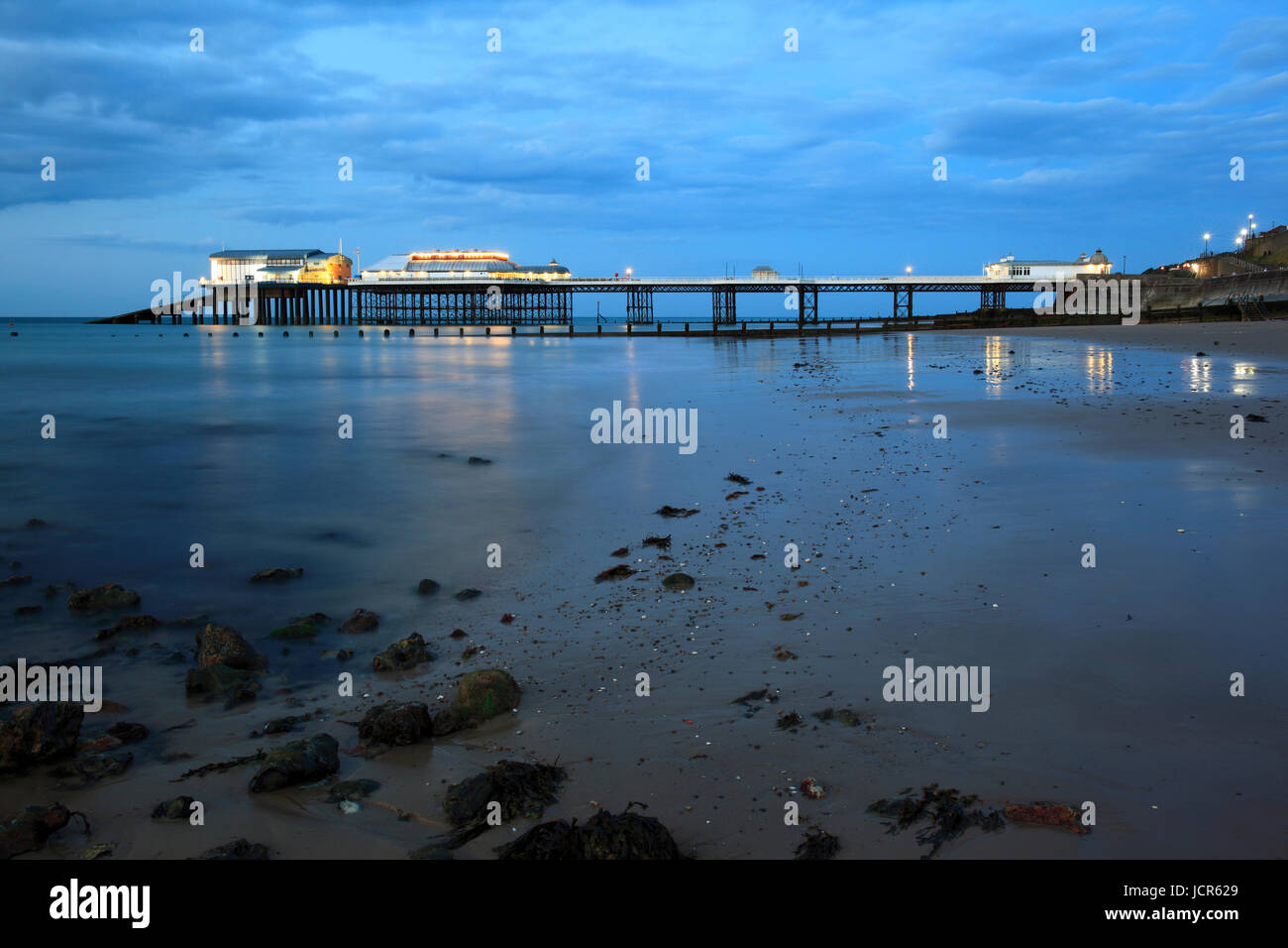 The pier illuminated at dusk, Cromer, North Norfolk, England, Europe - Stock Image