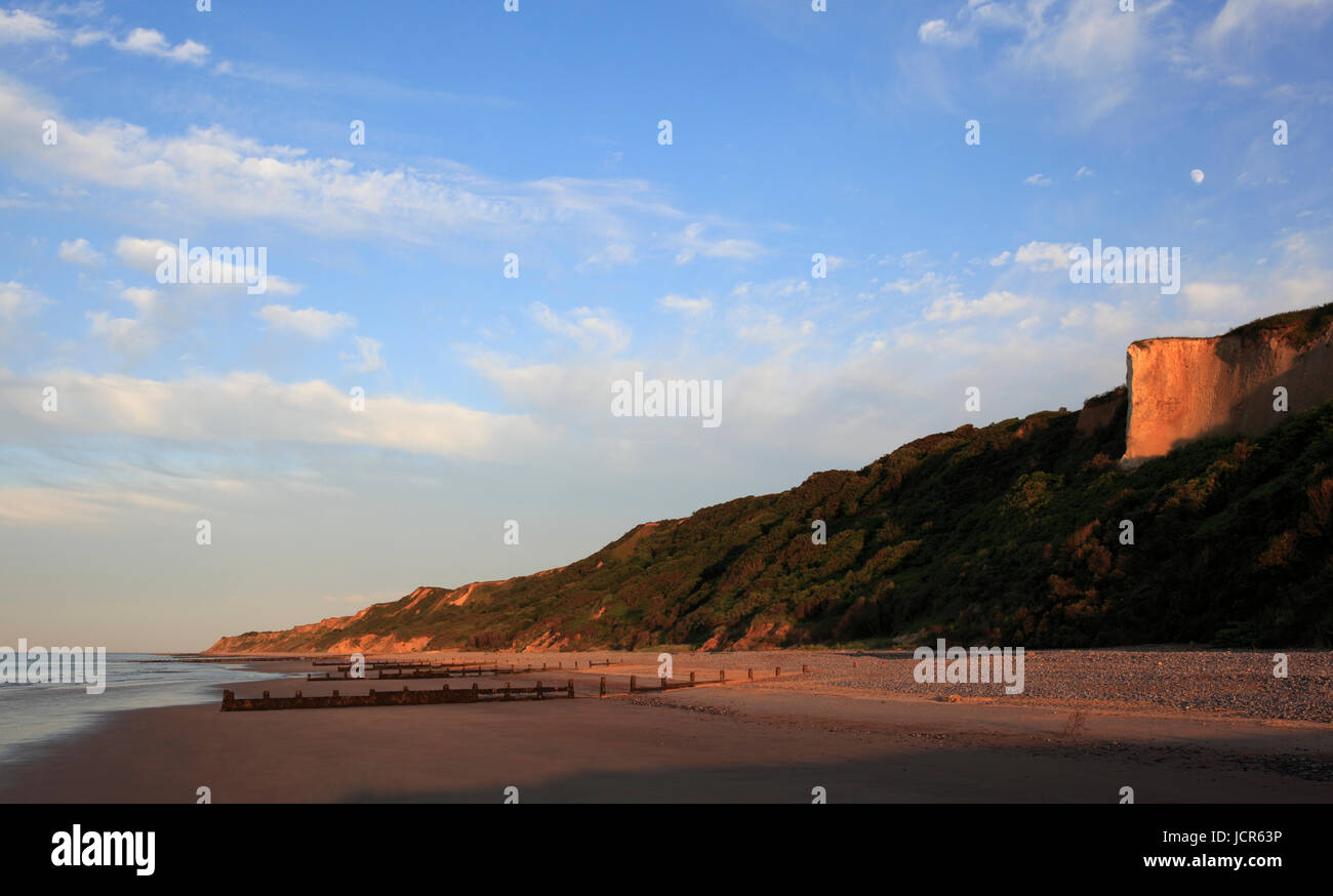 Warm light bathes the Cromer coastline, Cromer, Norfolk, England, Europe - Stock Image