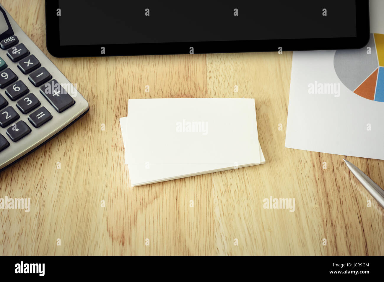 name card graph with calculator and tablet, vintage effect - Stock Image