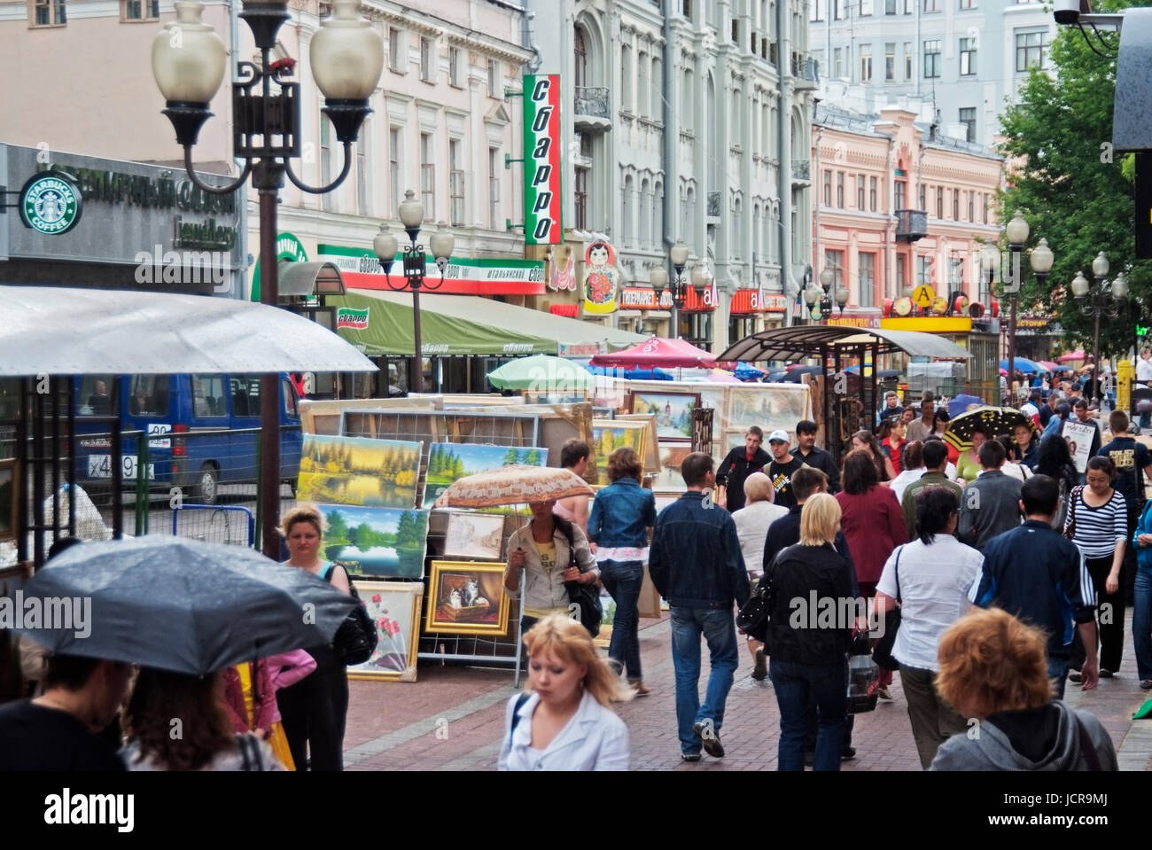 Arbat street, pedestrian street with souveniers like Russian Matryoshkas or military insignia of the Russian army, - Stock Image