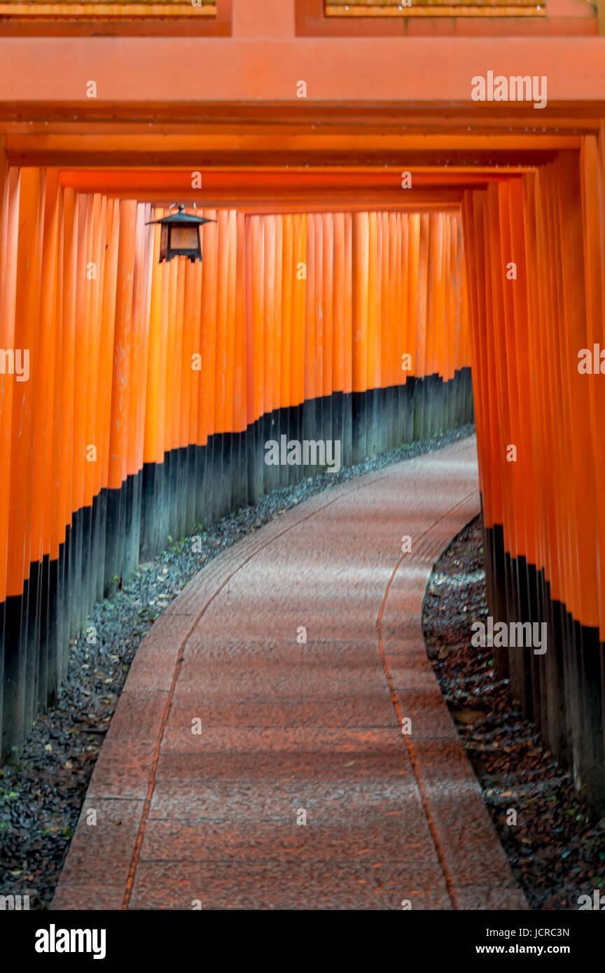 Fushimi Inari shinto shrine, Kyoto, path of torii Stock Photo