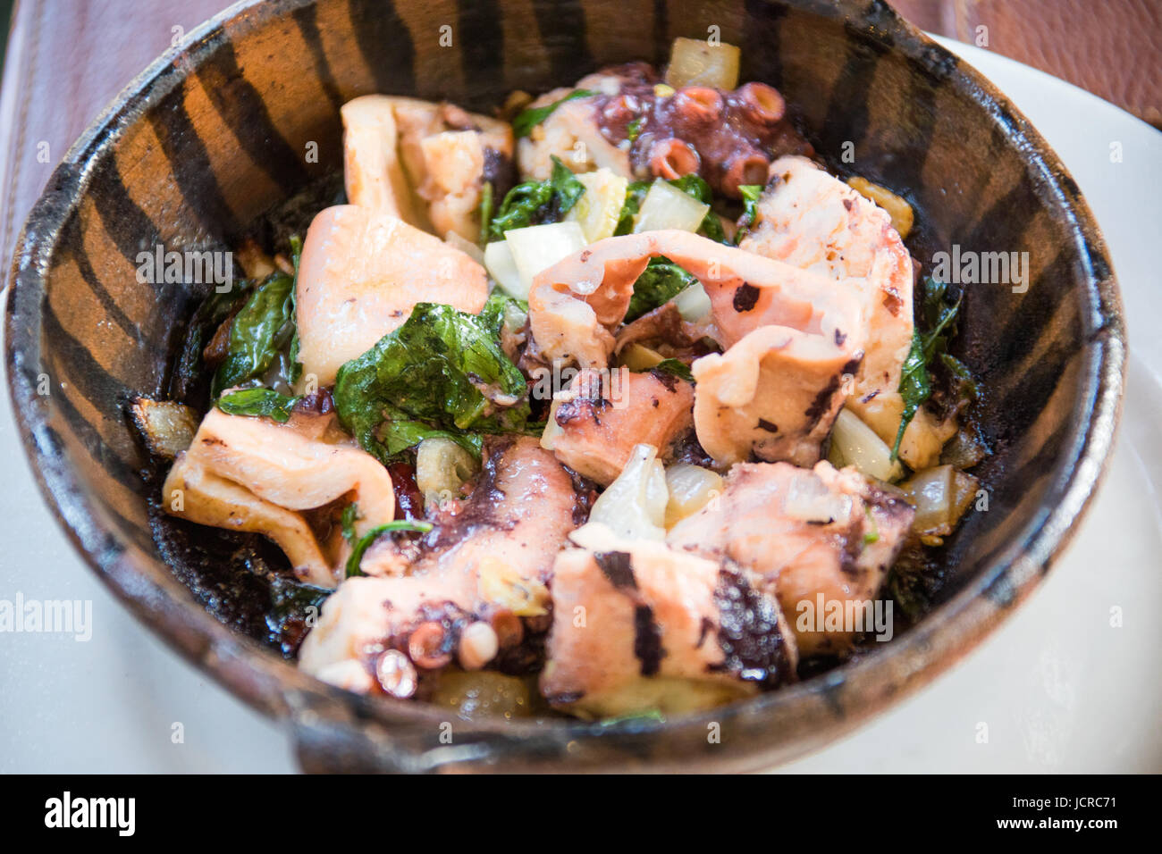 Octopus in oil, garlic, onions, and lemon, El Cardenal Restaurant, Mexico City, Mexico - Stock Image