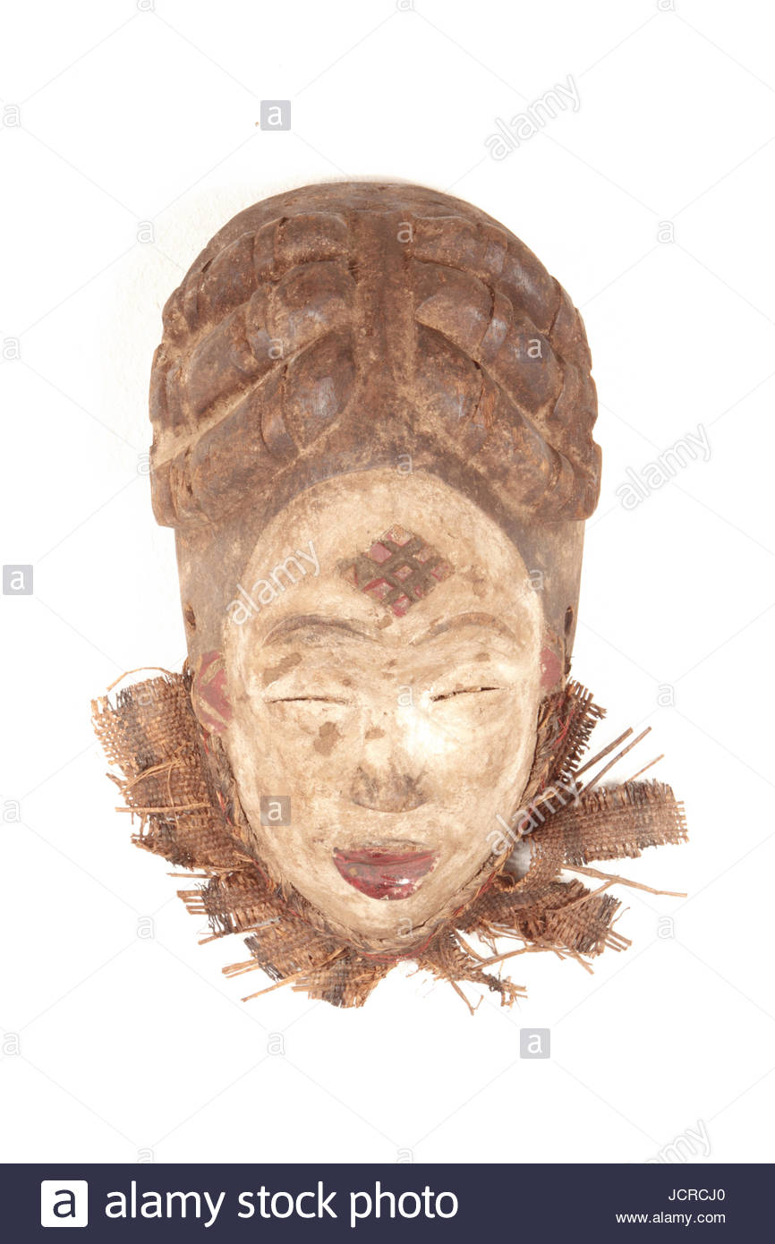 A wooden mask from a Punu tribe, of Cameroon. A rectangle divided into 9 smaller rectangles on the forehead is unique - Stock Image