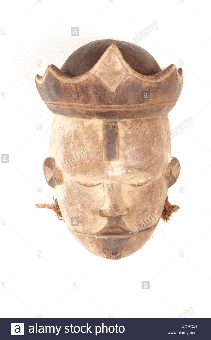 A mask from the Ogoni tribe of Nigeria with a special separate mandible. The separate mandible can be used as a - Stock Image