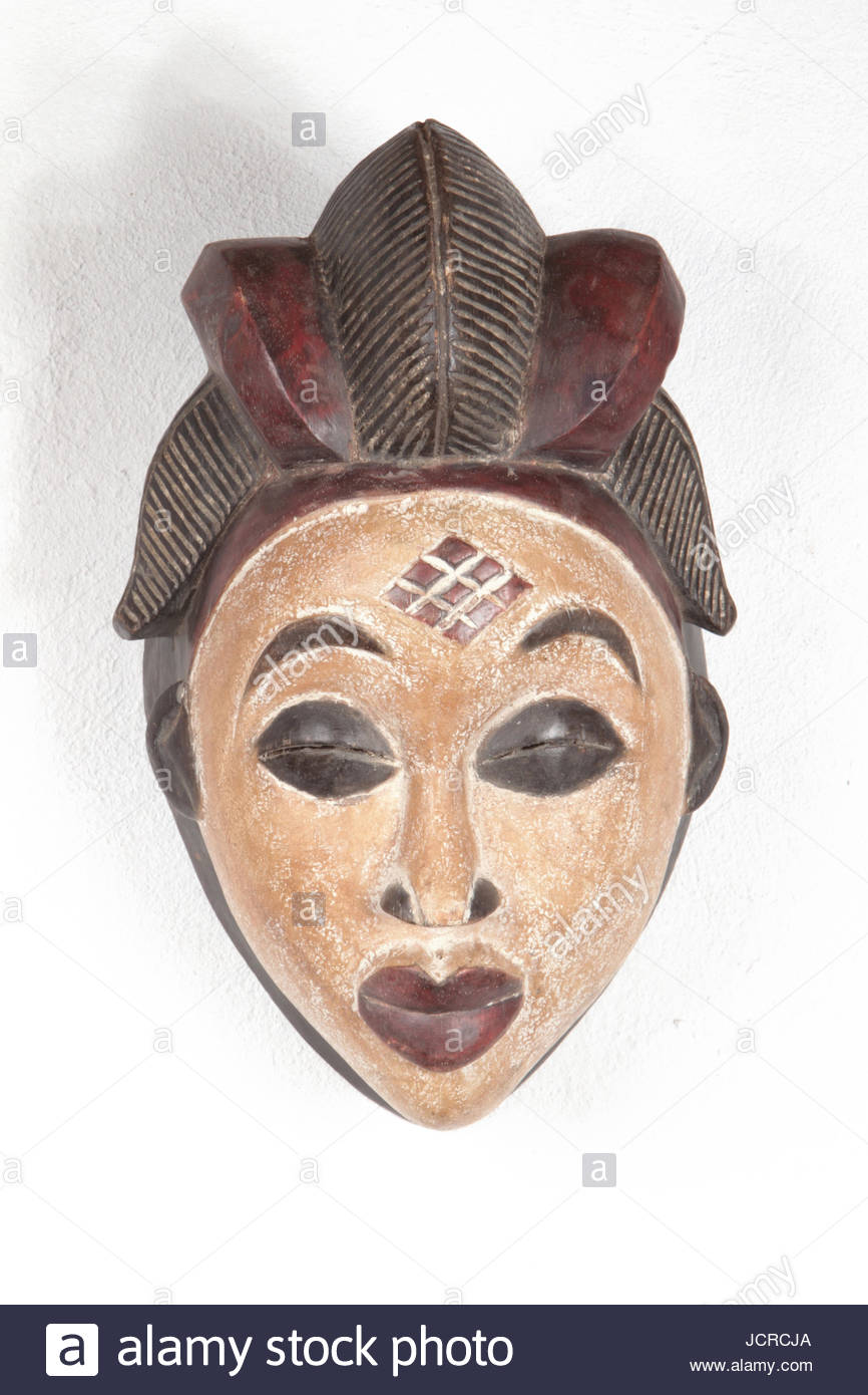 A wooden mask from a Cameroon Punu tribe. Small rectangles on the forehead indicate the particular Punu tribe. The - Stock Image