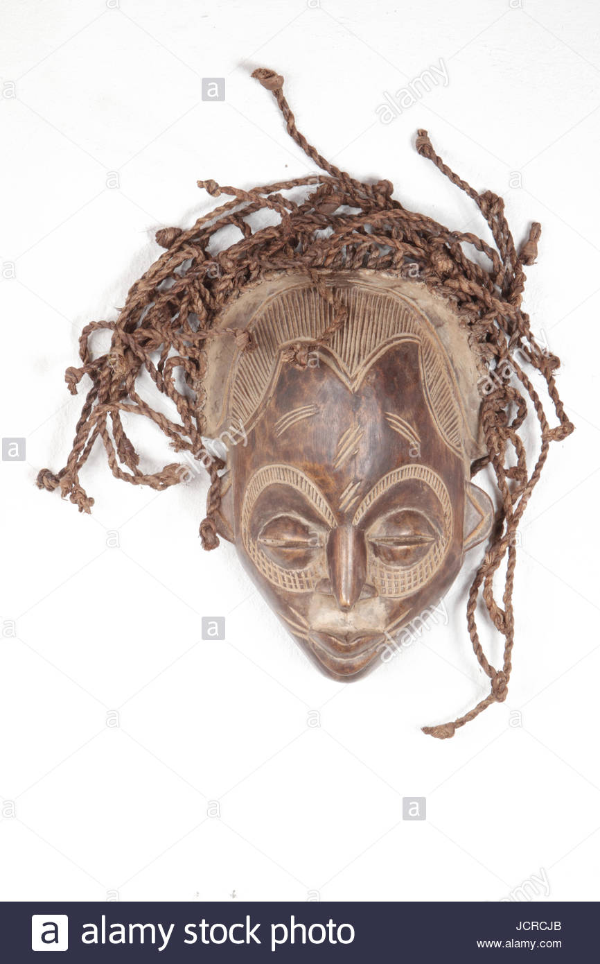 A mask from the Chokwe tribe, of Angola, with knotted hair made of rope. - Stock Image
