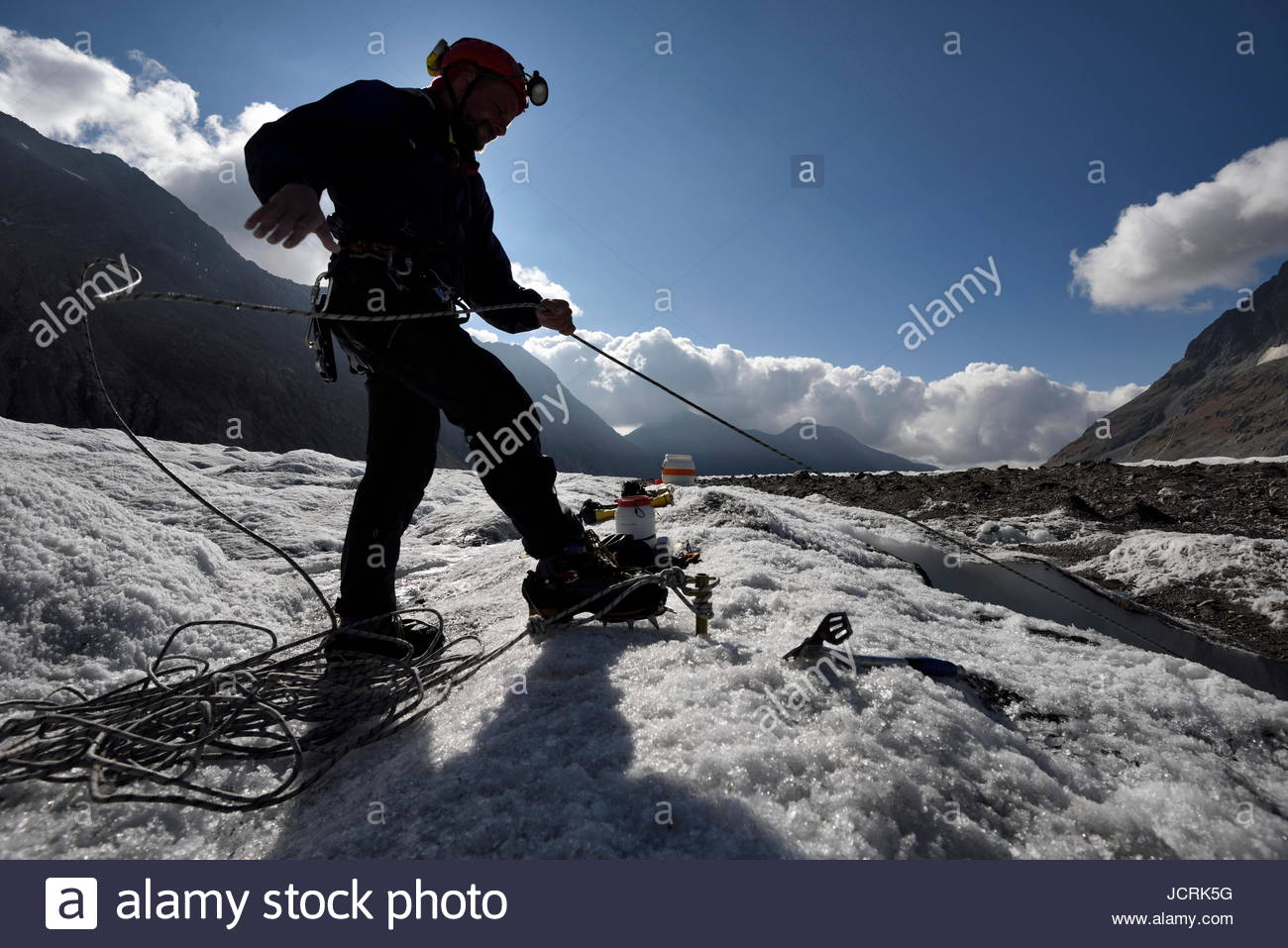 A cave explorer on the Aletsch Glacier in Switzerland. - Stock Image