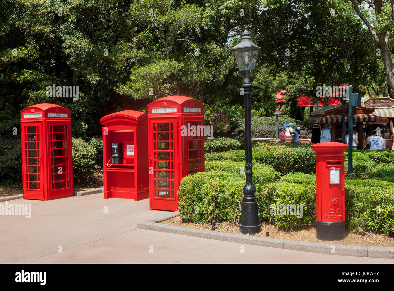 Iconic red phone boxes and mail box at Epcot theme park in Orlando, Florida. - Stock Image