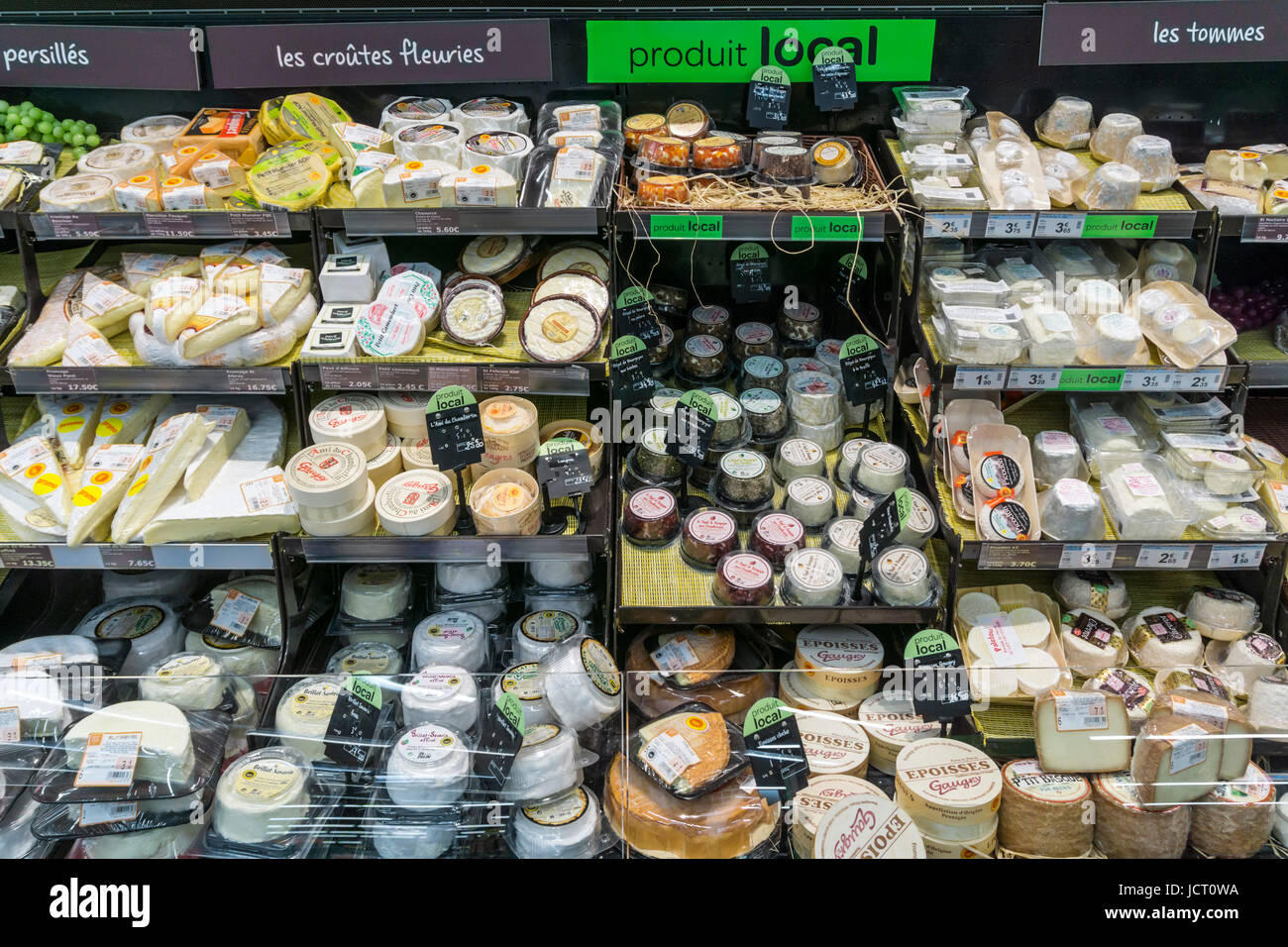 Locally produced cheese for sale in a French supermarket under a Produit Local sign - Stock Image